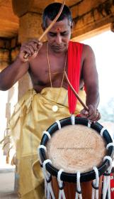 Prisoner playing Chenda, the percussion