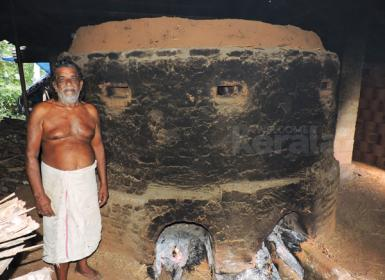 Potter - Kuttan infront of his furnace